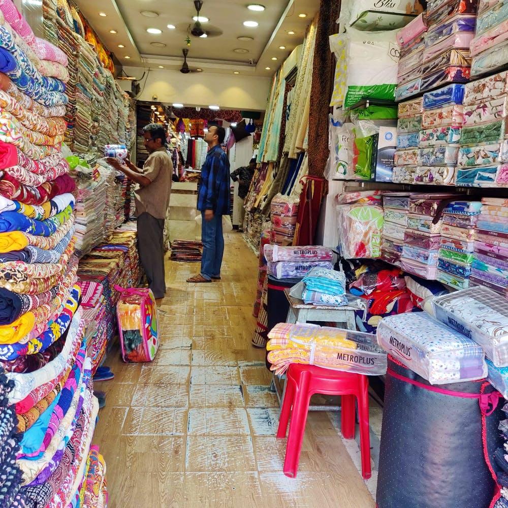 Selling,Marketplace,Bazaar,Market,Public space,Retail,Human settlement,Shopping,Convenience store,Building