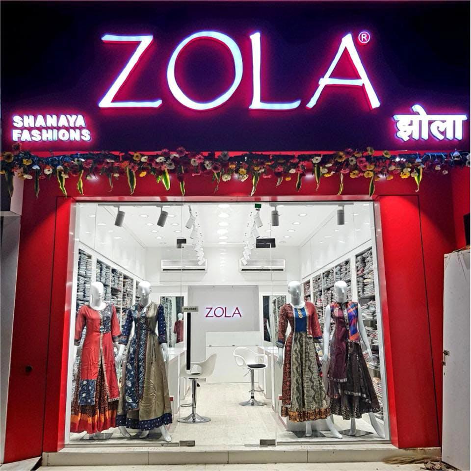 Boutique,Outlet store,Building,Fashion,Footwear,Architecture,Facade,Retail,Electronic signage,Shoe