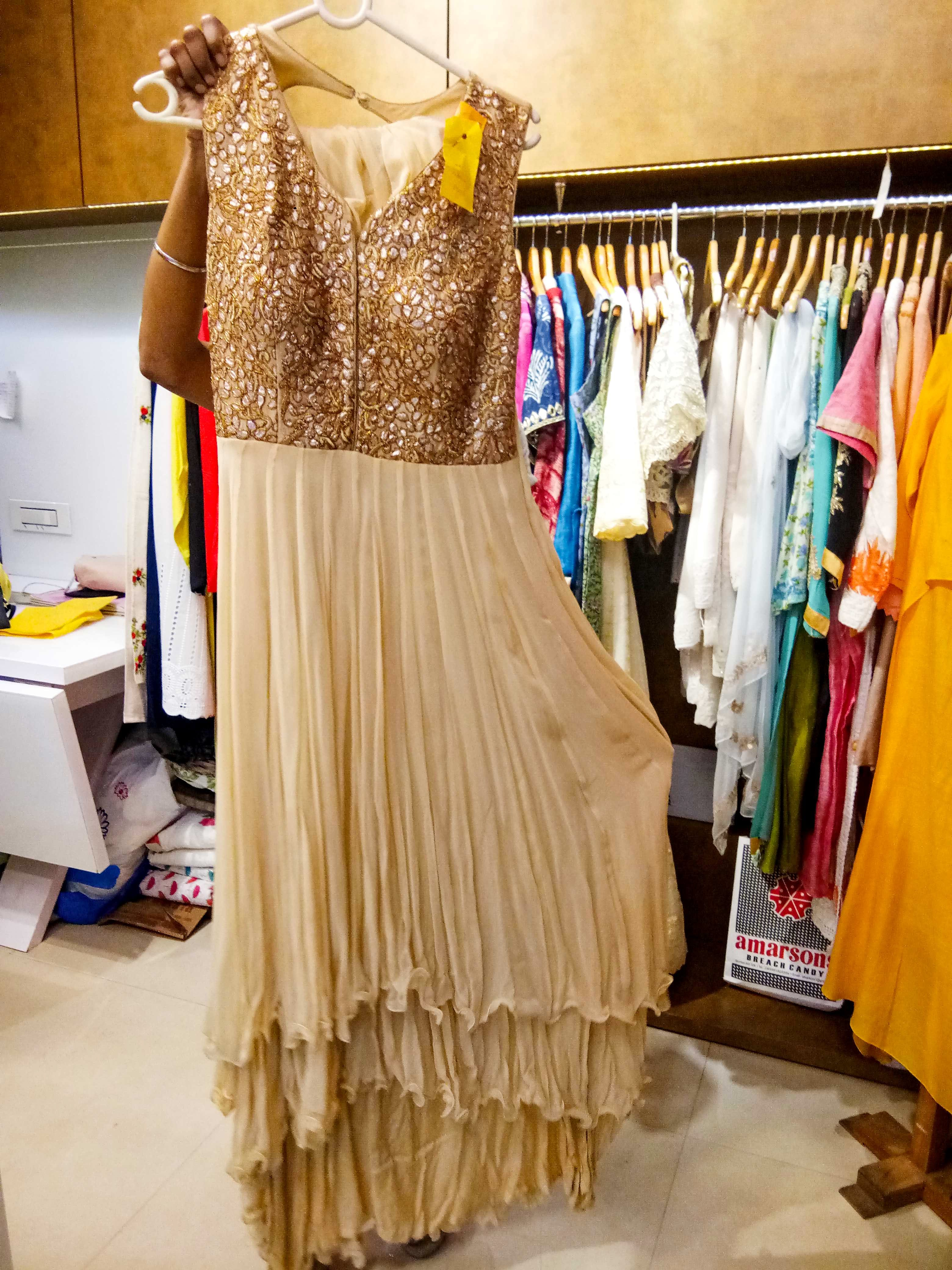 Dress,Clothing,Boutique,Yellow,Formal wear,Costume design,Fashion,Fashion design,Room,Gown