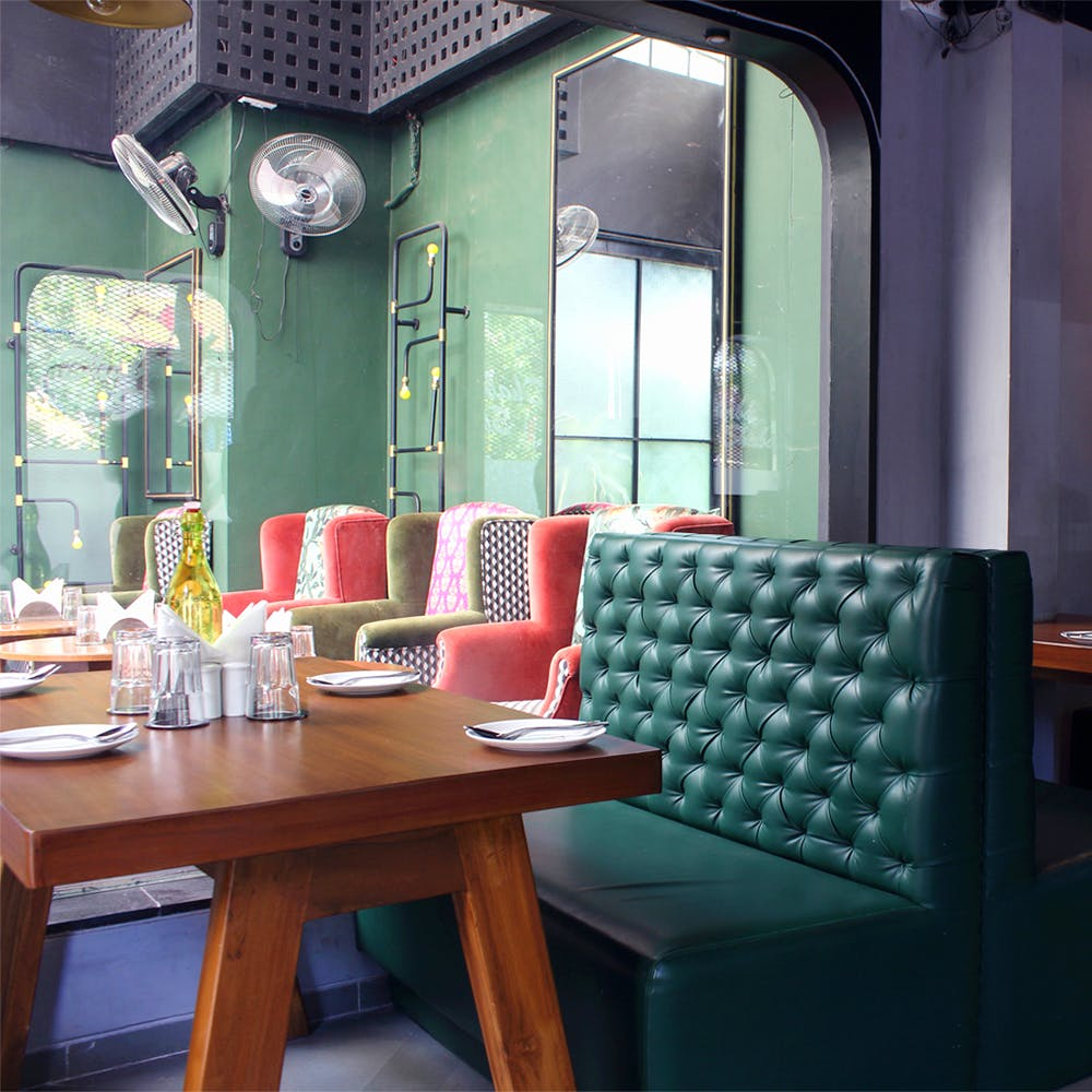 Green,Room,Furniture,Interior design,Table,Building,Chair,Architecture,House,Restaurant