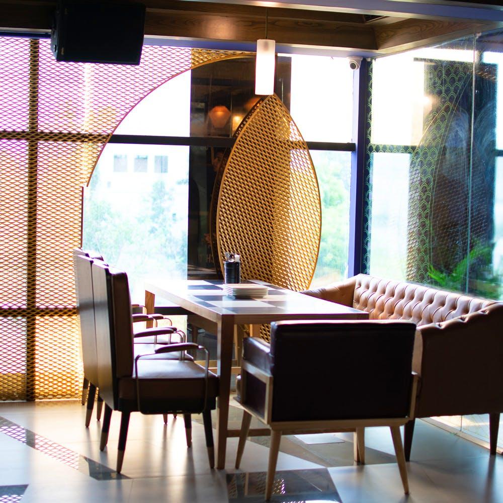 Room,Table,Furniture,Kitchen & dining room table,Interior design,Dining room,Lighting,Chair,Restaurant,Floor