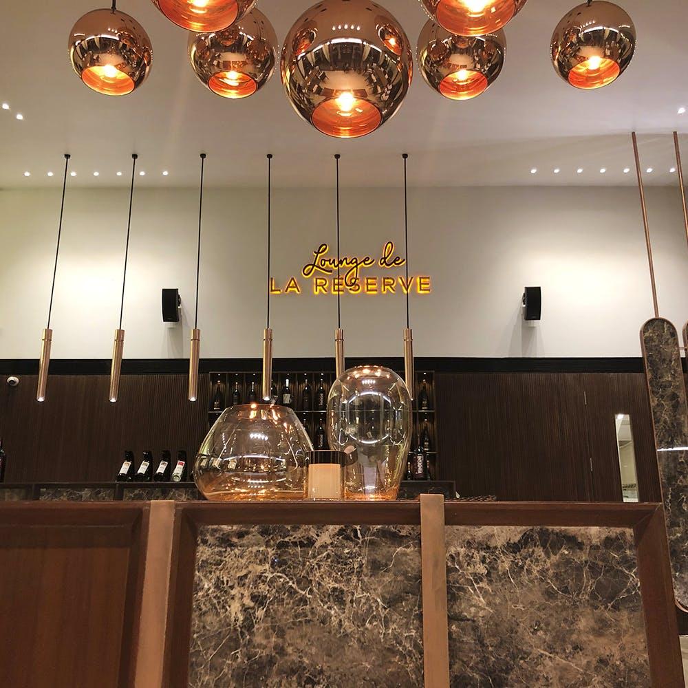 Lighting,Light fixture,Ceiling,Interior design,Room,Ceiling fixture,Chandelier,Lighting accessory,Interior design,Restaurant