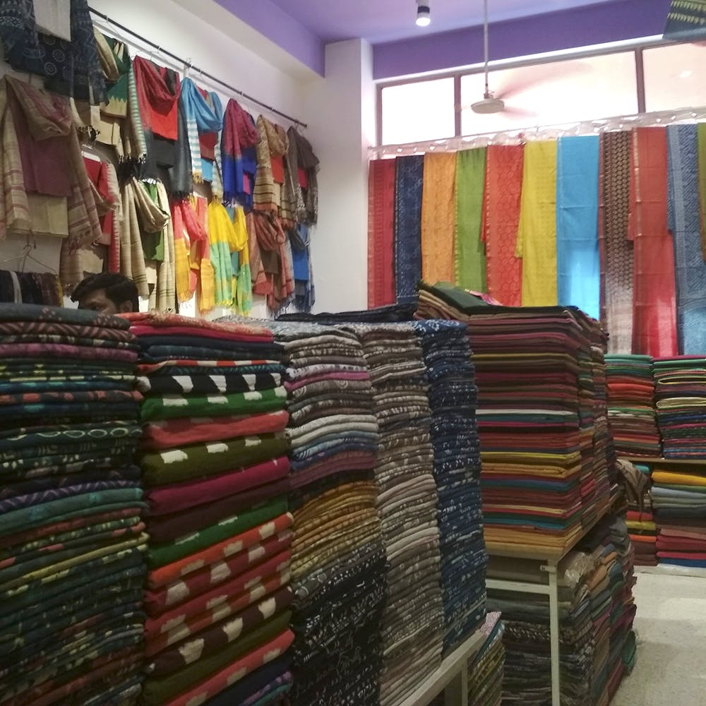 Textile,Room,Retail,Building,Outlet store,Wood,Interior design,Furniture,Collection,Book