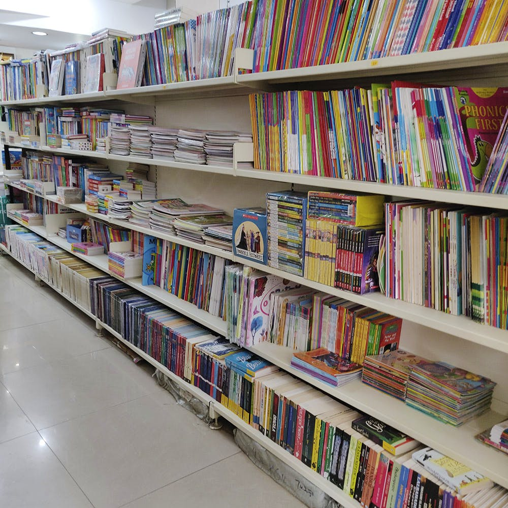 Library,Shelving,Shelf,Bookcase,Public library,Bookselling,Book,Publication,Furniture,Building
