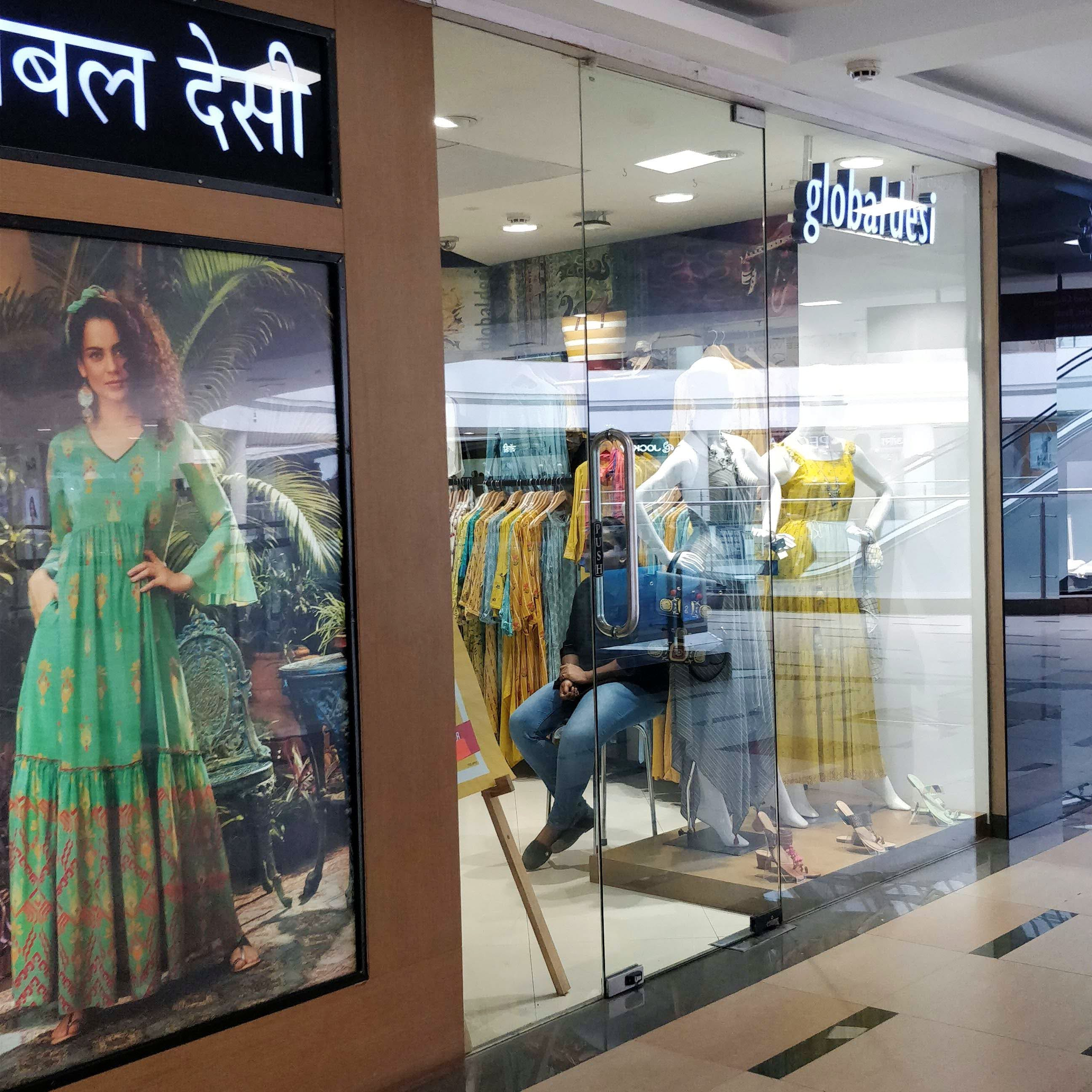 Building,Display window,Shopping mall,Retail,Glass,Outlet store,Advertising,Boutique,Interior design,Metal