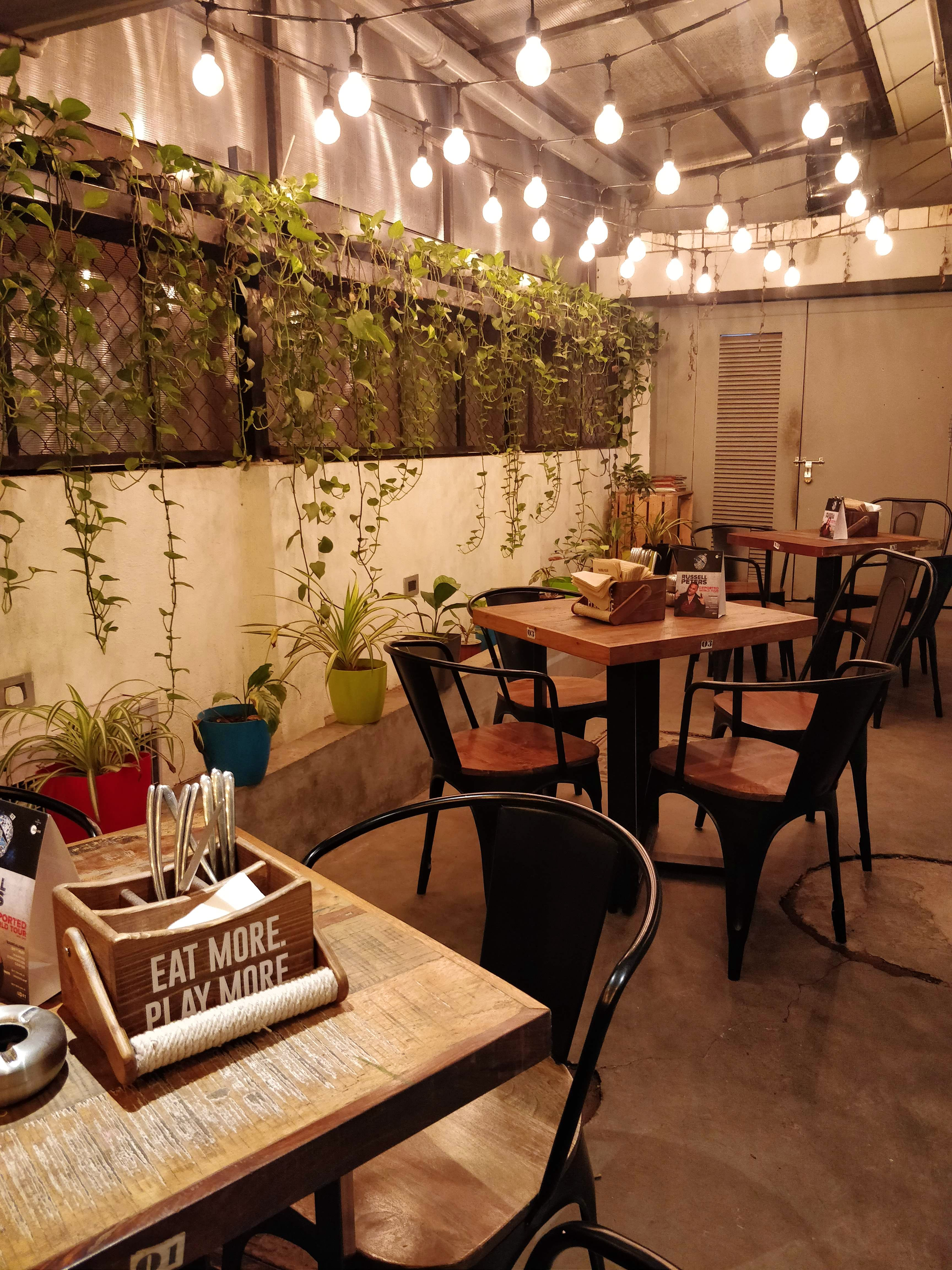Restaurant,Interior design,Property,Room,Building,Table,Furniture,Tree,Ceiling,Chair