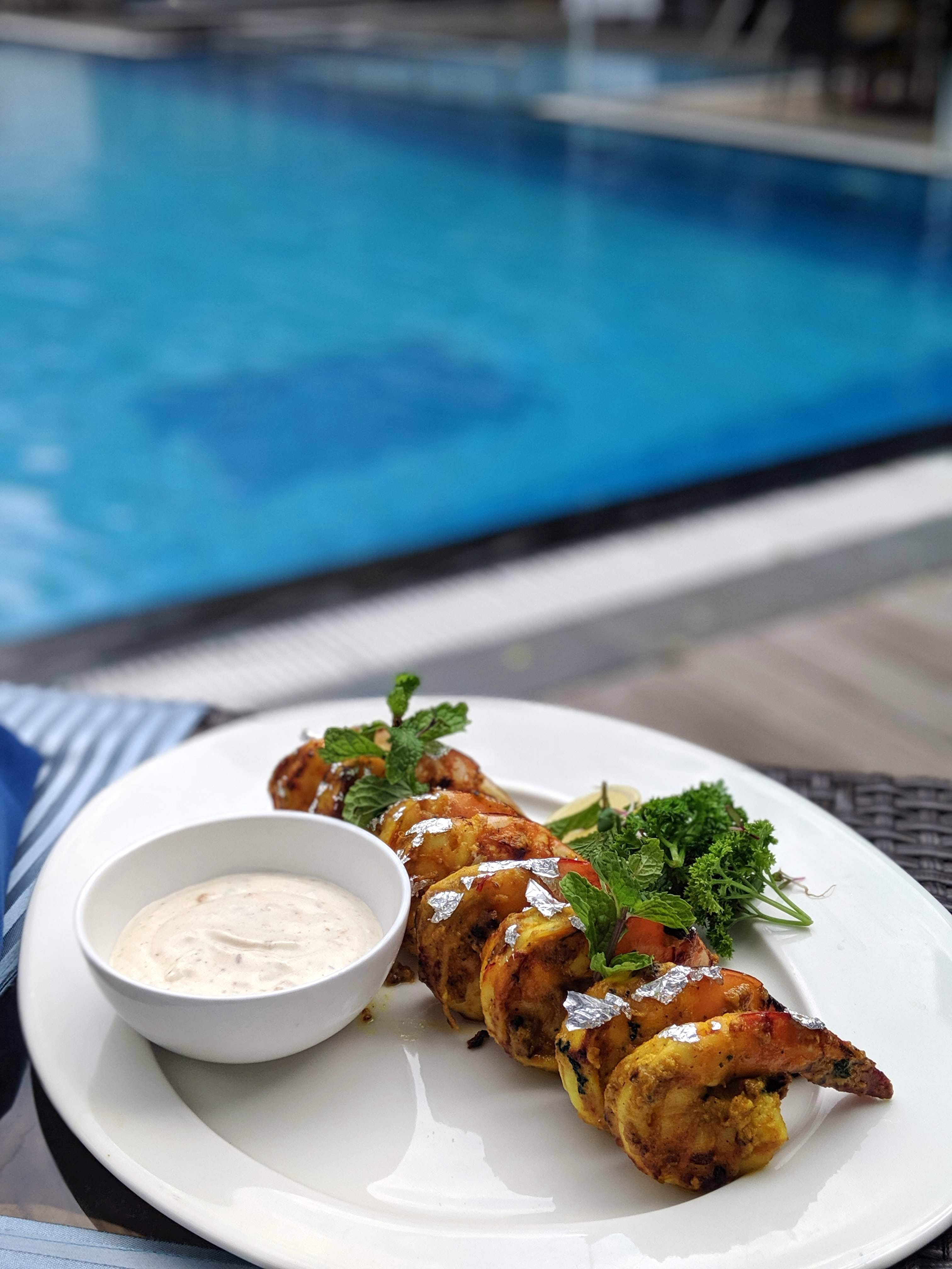 Buckle Up For Some Scrumptious Authentic Indian Meal By The Poolside