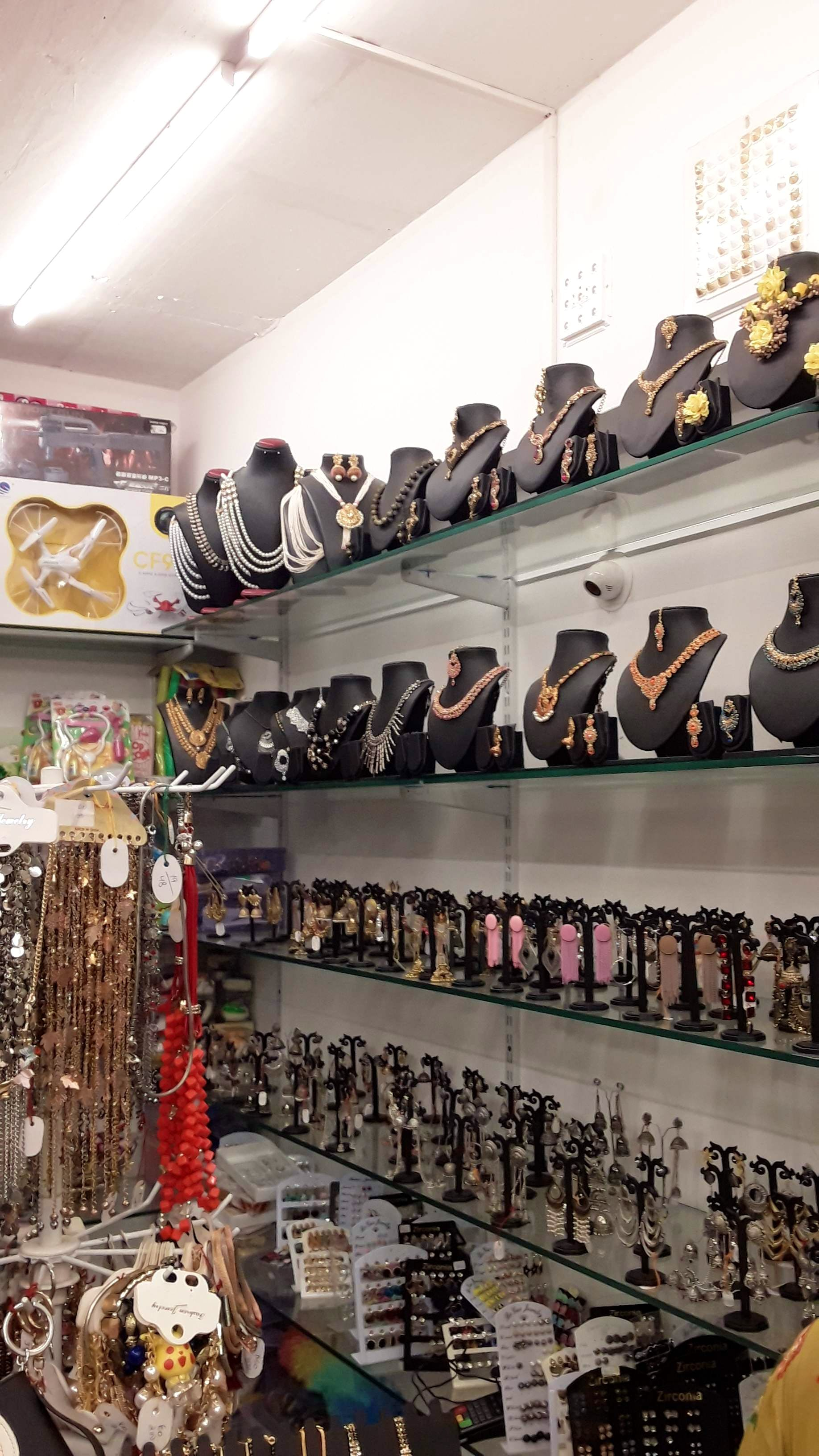 Footwear,Shoe store,Boutique,Shoe,Outlet store,Room,Collection,Building,Closet,Shelf