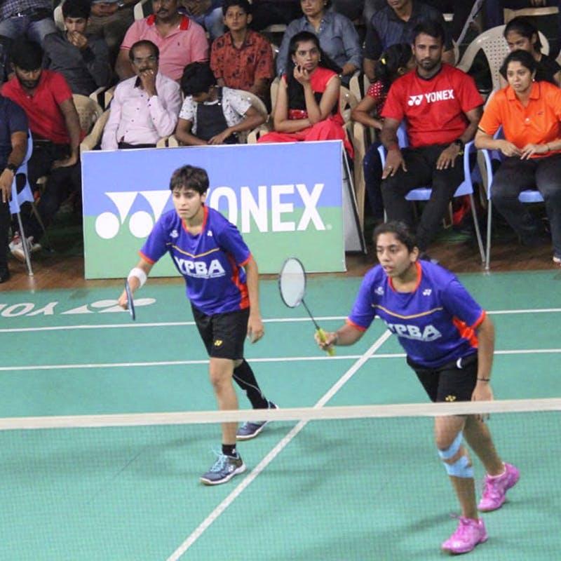 Sports,Ball game,Team sport,Badminton,Player,Sports equipment,Tournament,Play,Net sports,Sport venue