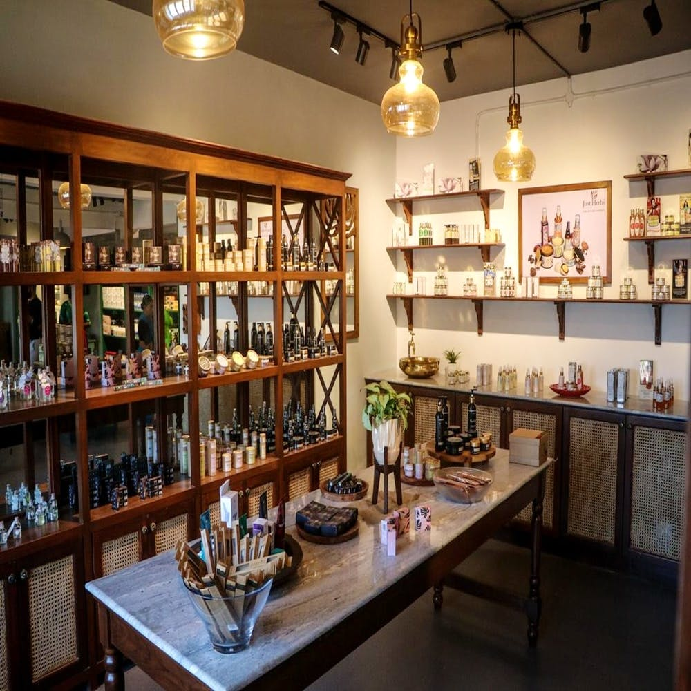 Building,Room,Interior design,Collection,Barware,Furniture,Distilled beverage,Shelving,Liquor store,Tavern