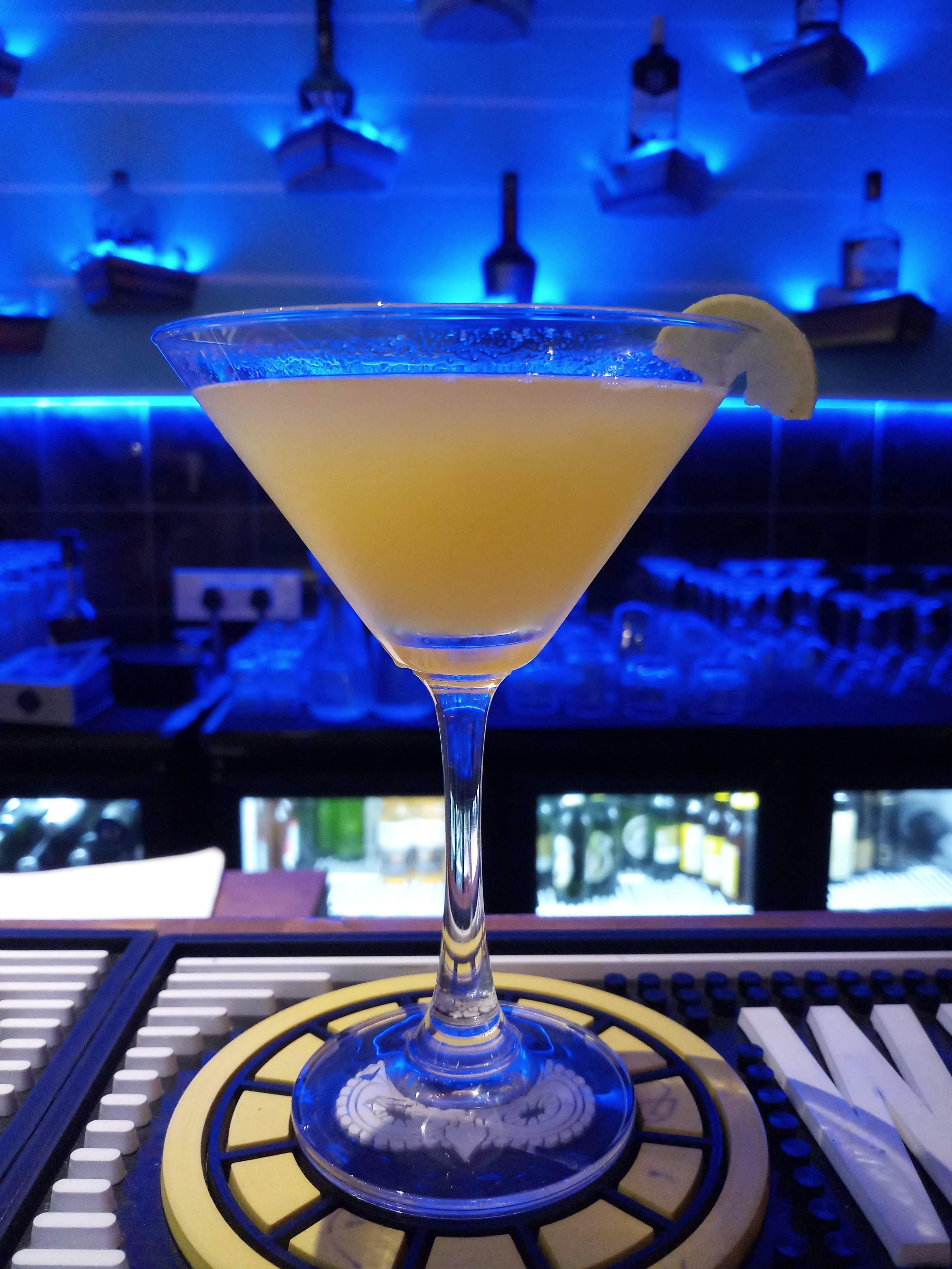 Drink,Alcoholic beverage,Martini glass,Classic cocktail,Distilled beverage,Liqueur,Daiquiri,Cobalt blue,Cocktail,Bacardi cocktail