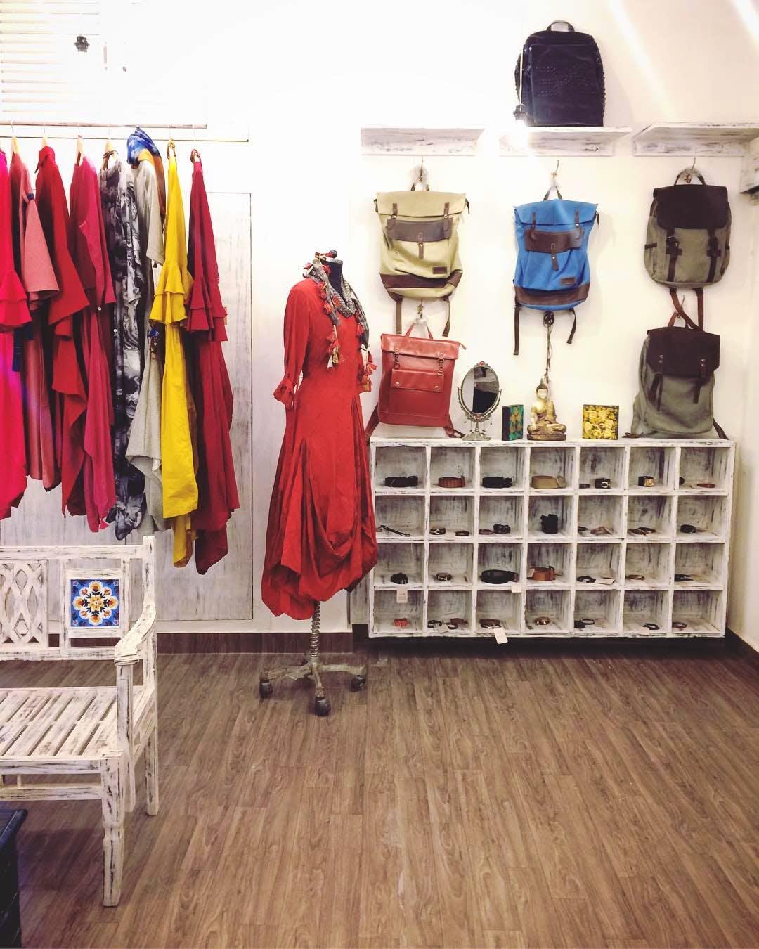 Room,Boutique,Clothes hanger,Fashion,Fashion design,Floor,Outerwear,Costume design,Flooring,Furniture
