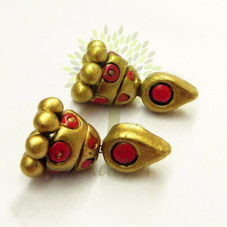 Jewellery,Fashion accessory,Earrings,Gemstone,Brass,Metal,Bead
