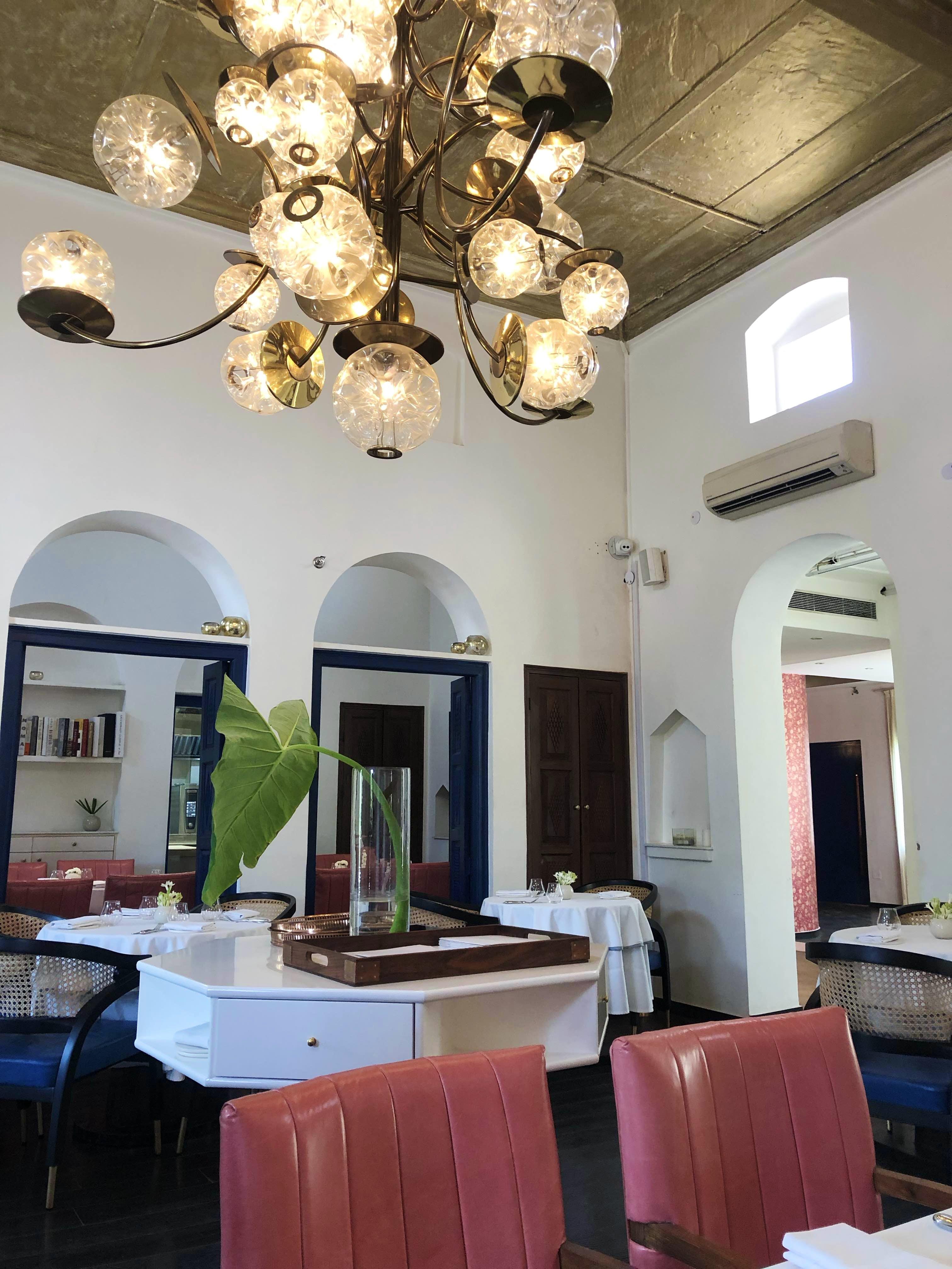 Ceiling,Room,Interior design,Property,Lighting,Chandelier,Light fixture,Dining room,Building,Table