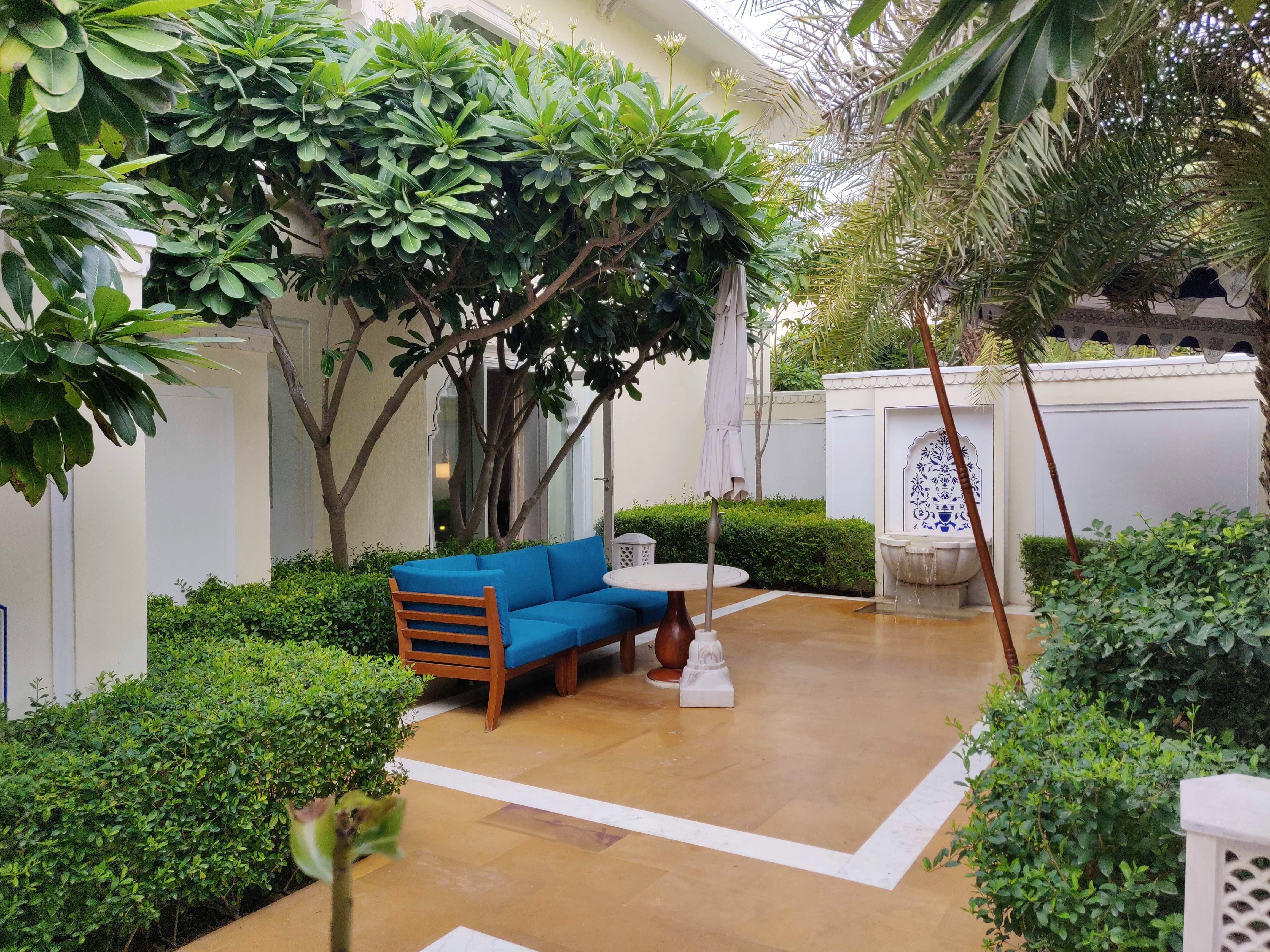Property,Backyard,Courtyard,Building,Real estate,House,Yard,Tree,Room,Garden