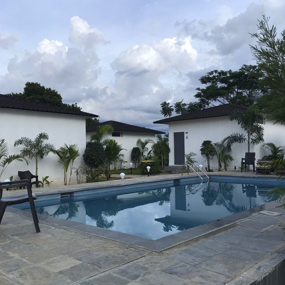Swimming pool,Property,House,Reflecting pool,Building,Real estate,Home,Architecture,Resort,Sky