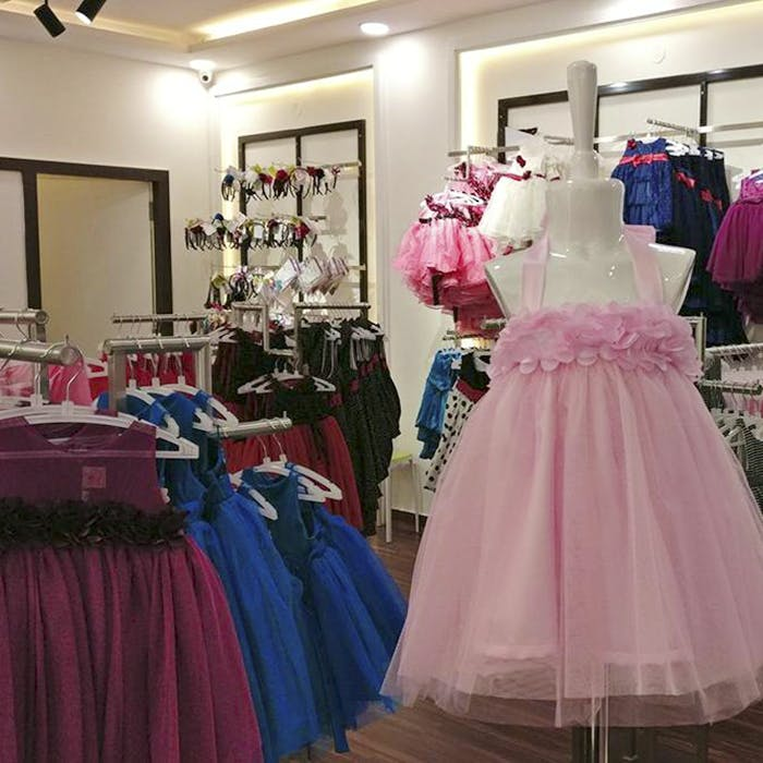Dress,Clothing,Pink,Gown,Boutique,Fashion,Formal wear,Room,Costume design,Cocktail dress