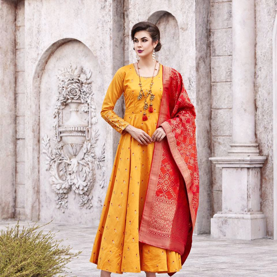 Clothing,Yellow,Orange,Formal wear,Dress,Maroon,Tradition,Embroidery,Fashion,Suit