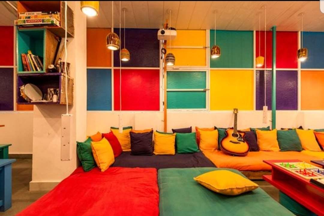 Room,Interior design,Orange,Furniture,Yellow,Building,Wall,House,Ceiling,Floor
