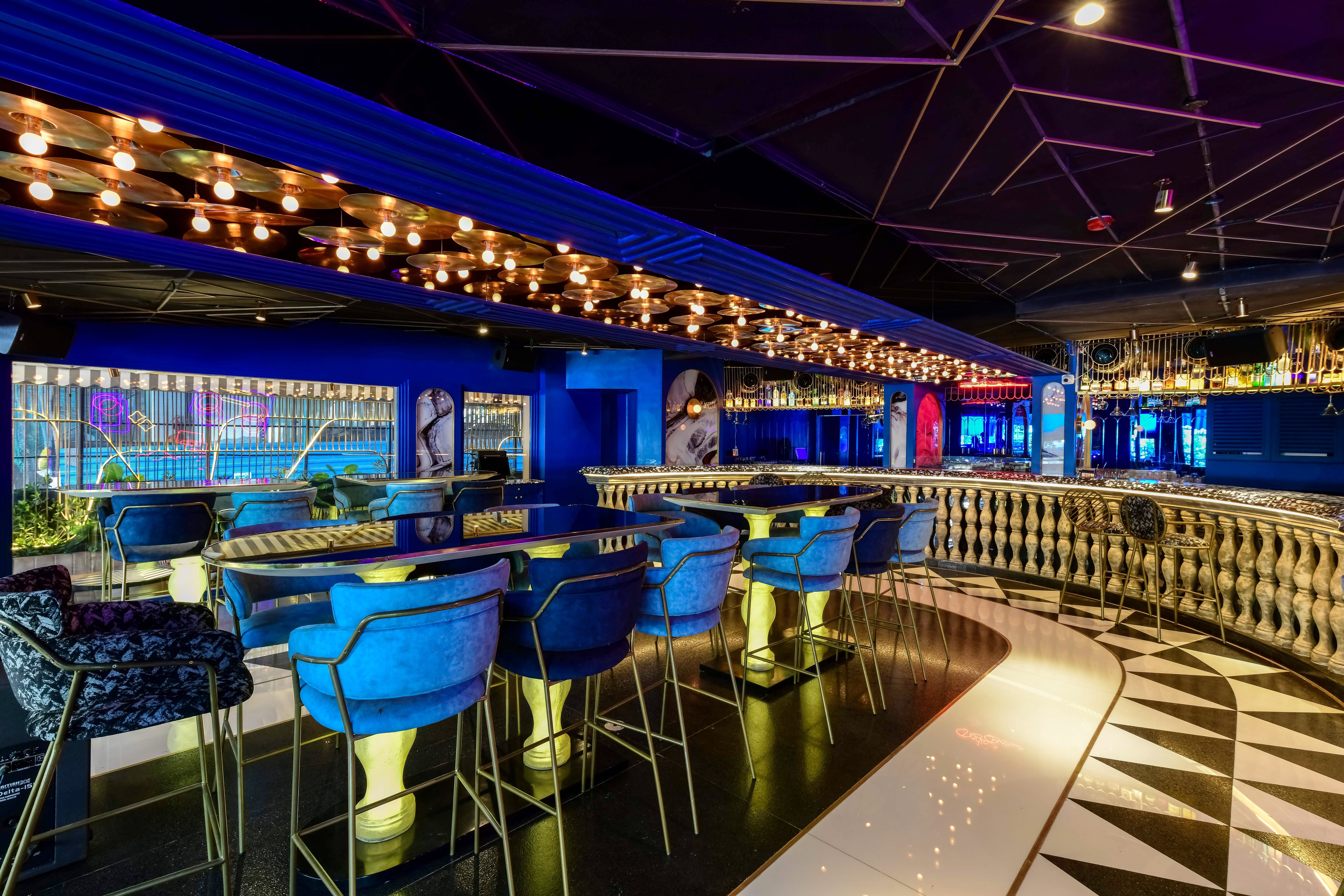 Lighting,Building,Architecture,Night,Restaurant,Bar,Interior design,Leisure,Sport venue,City