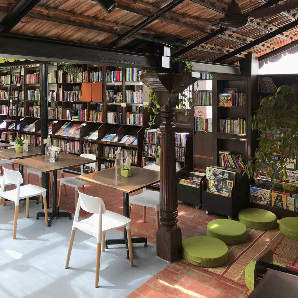 Building,Room,Furniture,Interior design,Table,Shelving,Library,Architecture,Tree,House