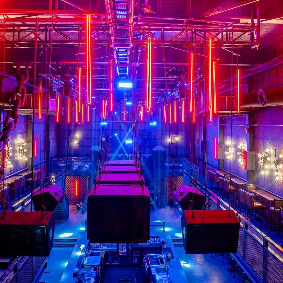 Light,Red,Lighting,Visual effect lighting,Neon,Music venue,Luxury vehicle,Technology,Magenta,Stage