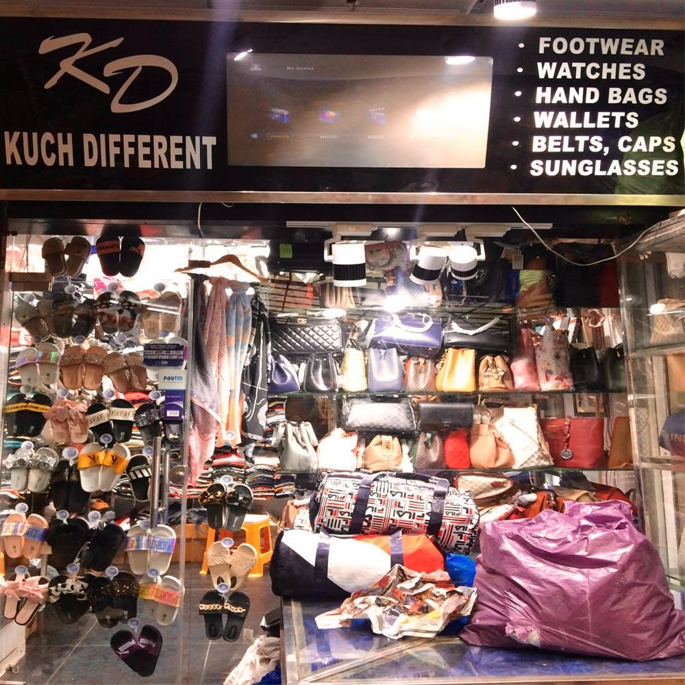 Footwear,Outlet store,Building,Boutique,Shoe,Retail,Fashion accessory,Bazaar,Athletic shoe
