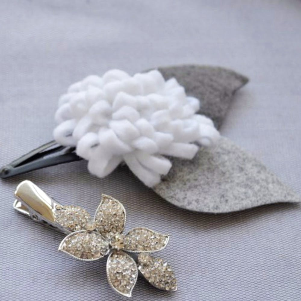 Leaf,Fashion accessory,Petal,Jewellery,Brooch,Flower,Hair accessory,Plant,Hydrangea