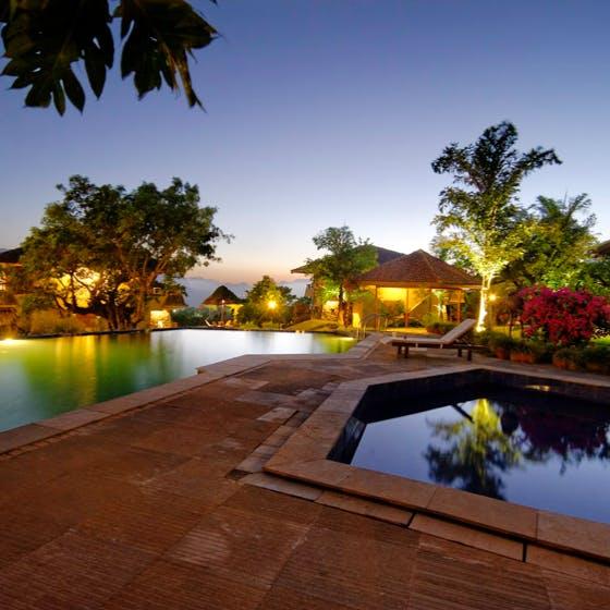 Property,Swimming pool,Resort,Lighting,Home,Tree,Sky,Real estate,Palm tree,House