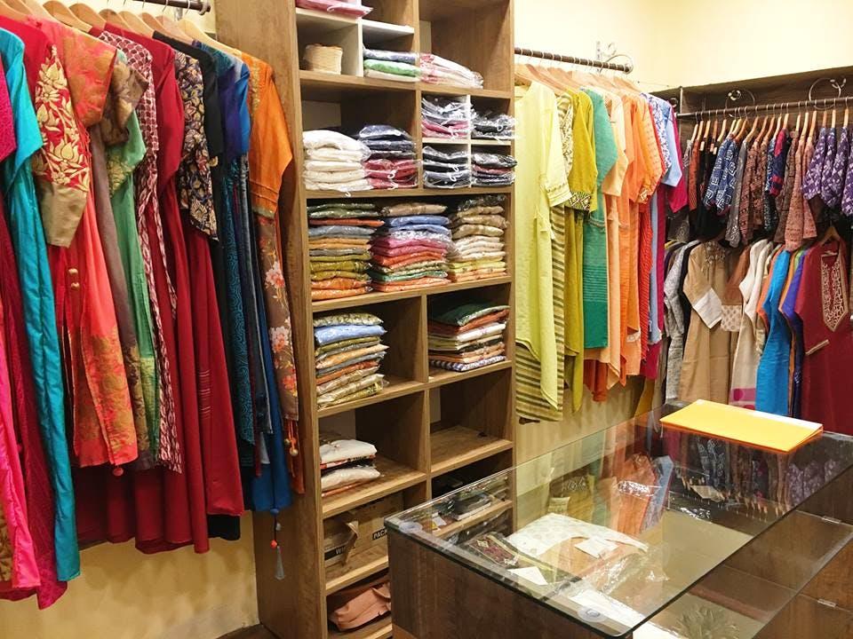 Room,Closet,Textile,Outlet store,Furniture,Retail,Building,Boutique,Shelving,Shelf