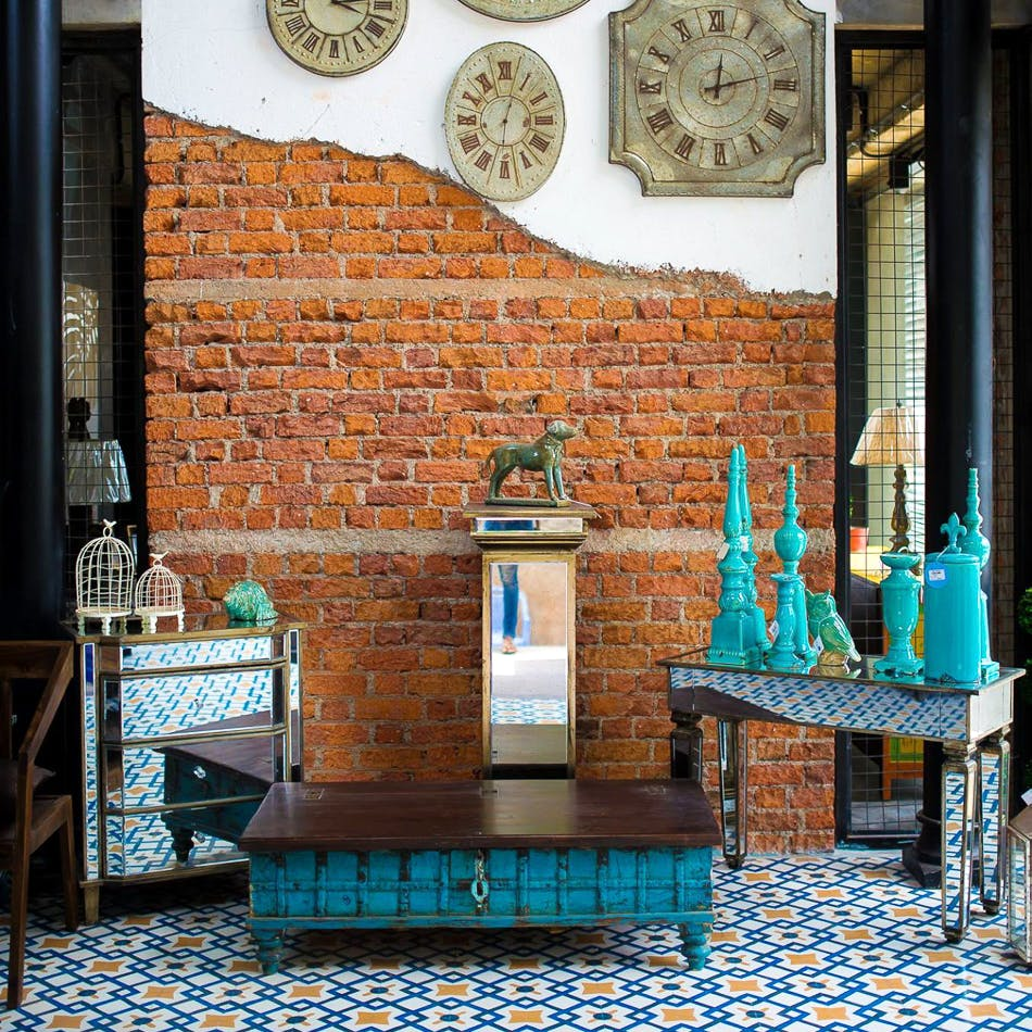 Blue,Turquoise,Room,Wall,Brick,Furniture,Interior design,Table,Brickwork,Building