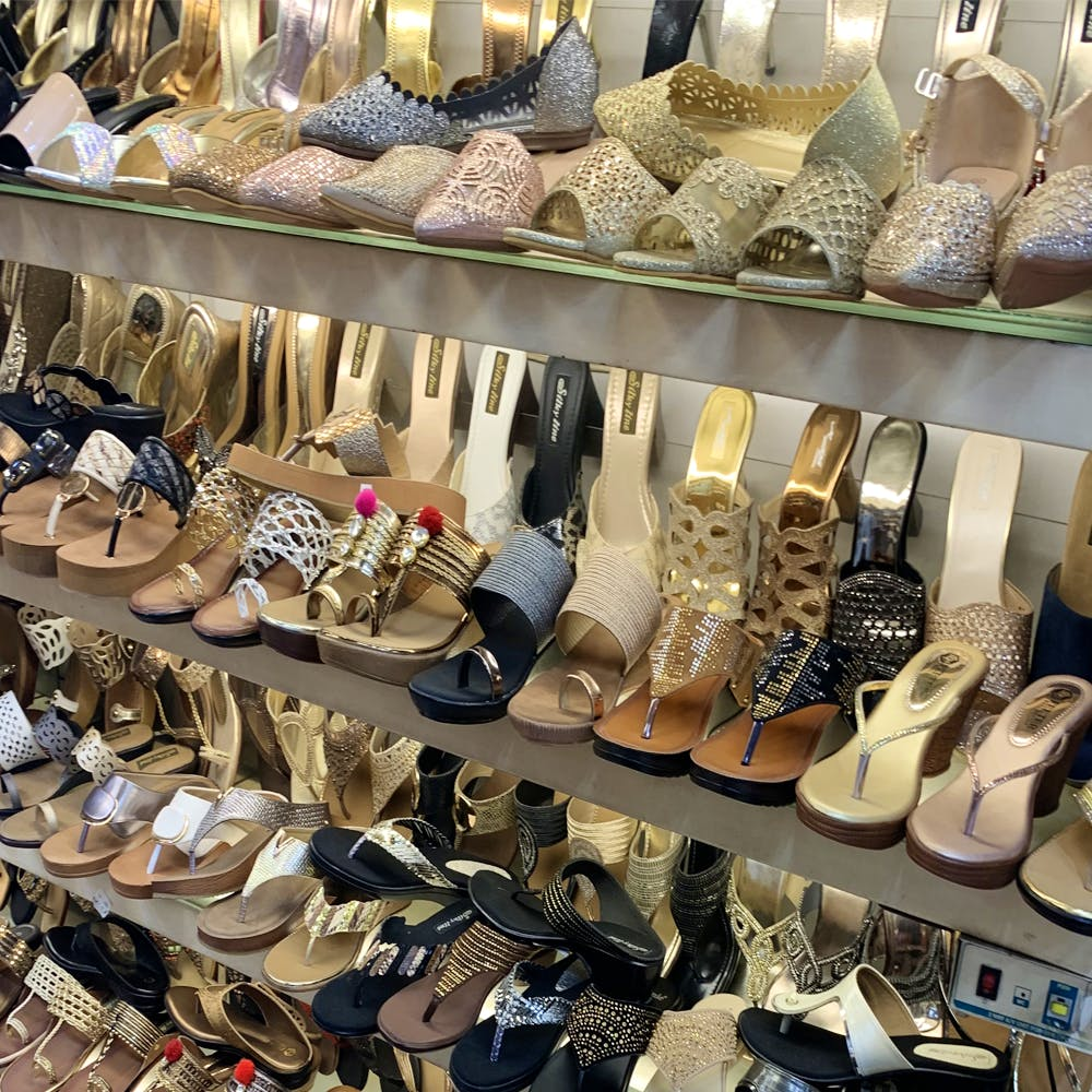 Footwear,Shoe store,Shoe,Dress shoe,High heels,Collection,Retail,Building,Hiking boot,Outlet store