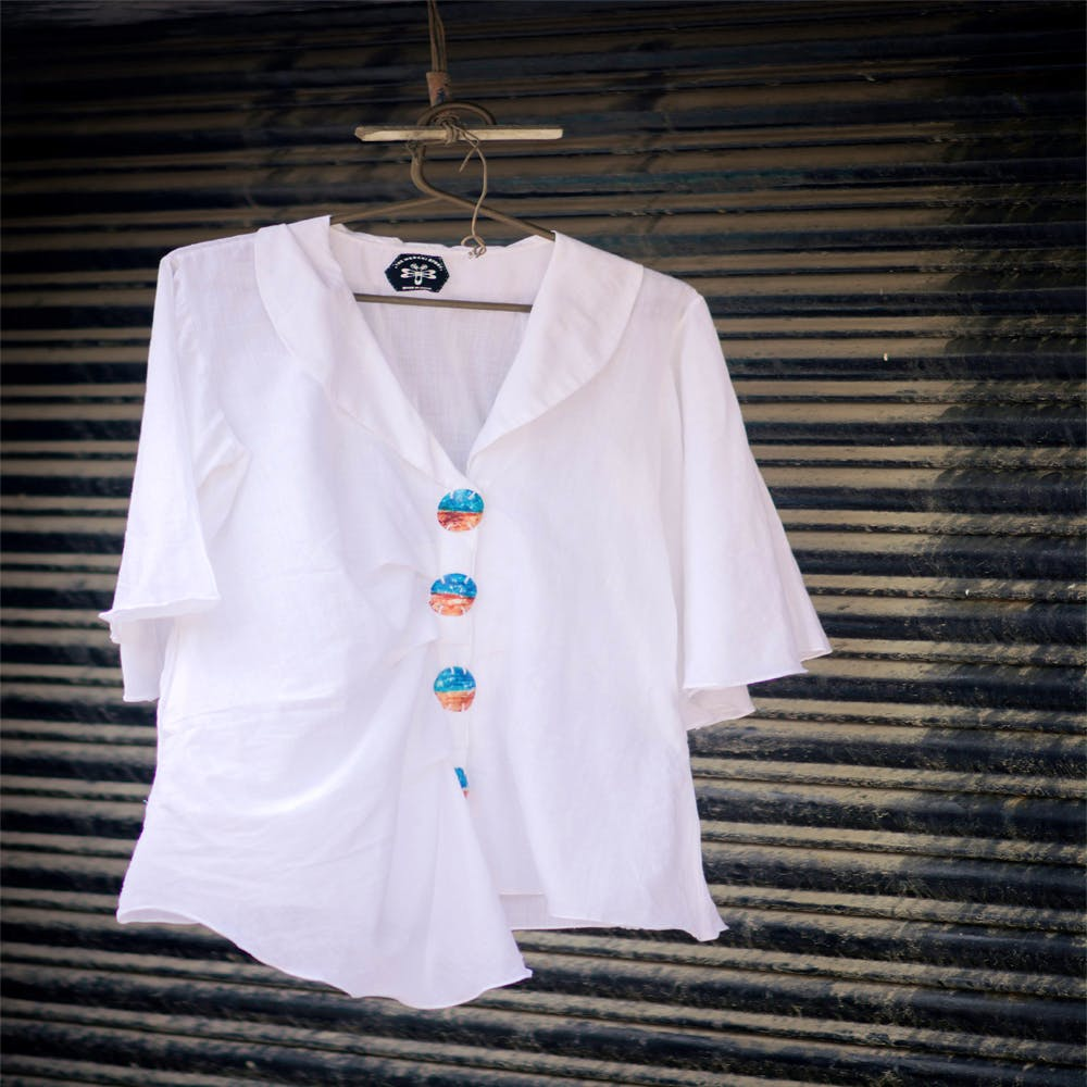 White,Clothing,Clothes hanger,Outerwear,Sleeve,Top,Blouse,Shirt,T-shirt,Button