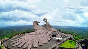 Landmark,Landscape,Photography,Historic site,Bird of prey,Mountain,Roof,Wing,Tourist attraction,Mountain range
