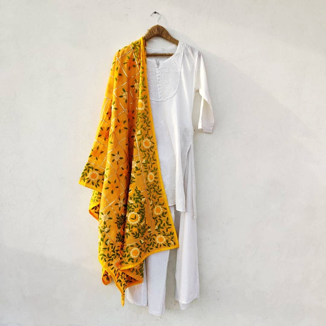 Clothing,Yellow,Outerwear,Clothes hanger,Sleeve,Blouse,Textile,Wrap,Dress,Costume