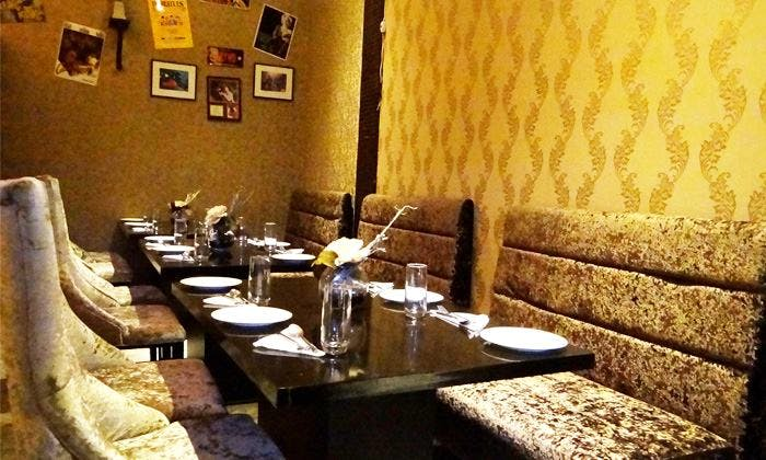 Room,Restaurant,Property,Interior design,Wall,Yellow,Table,Furniture,Building,Dining room