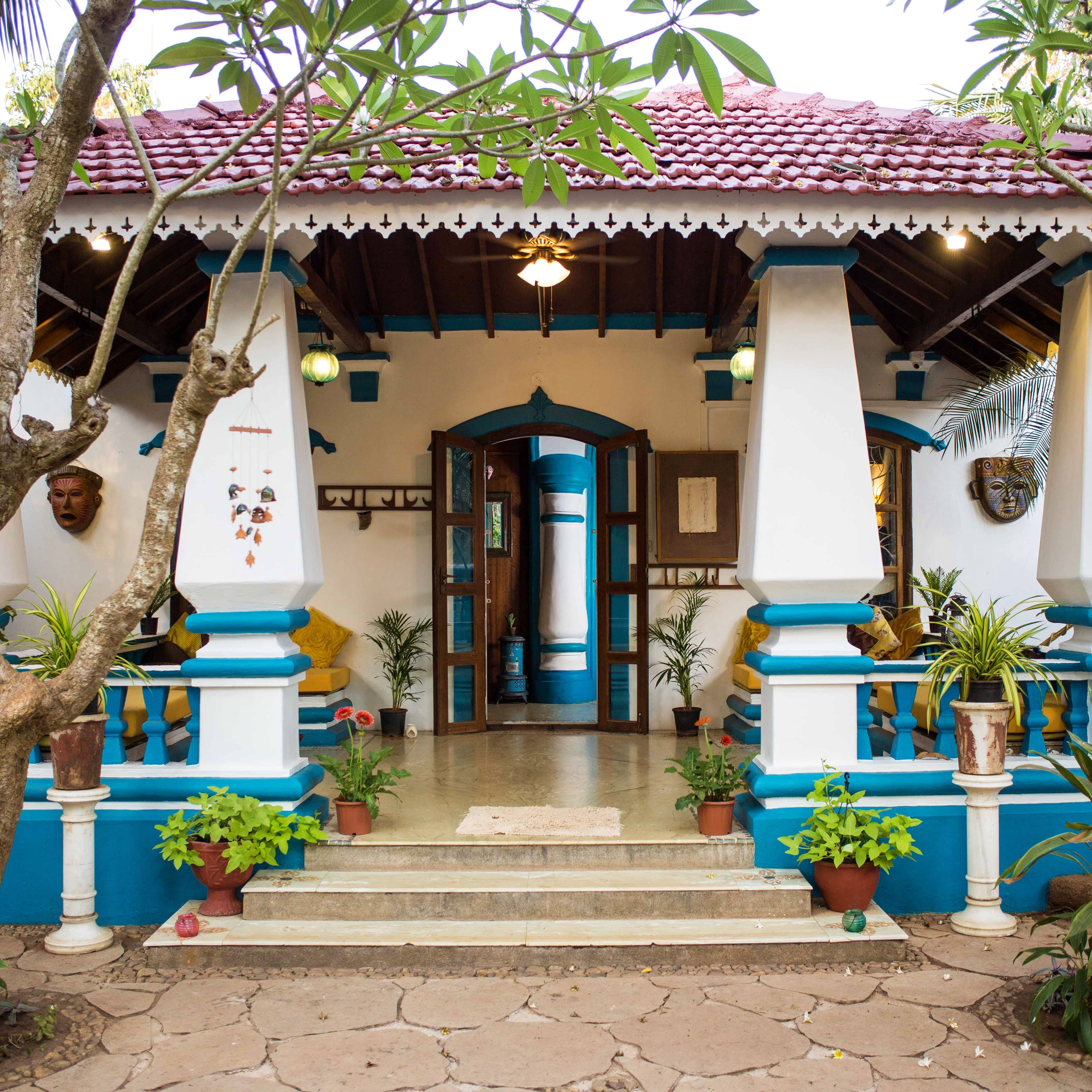 Building,Majorelle blue,House,Architecture,Facade,Leisure,Courtyard,Temple,Plant,Home