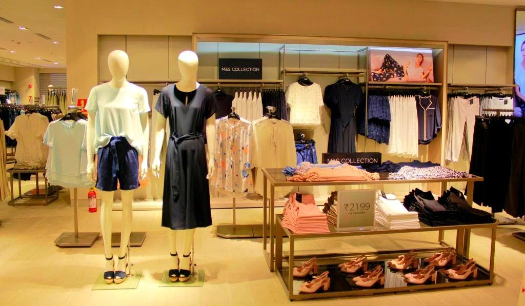 Boutique,Retail,Outlet store,Fashion,Building,Room,Footwear,Display window,Wardrobe,Fashion design