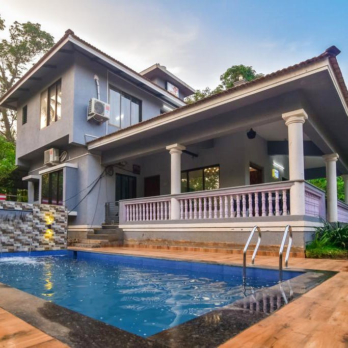 Property,House,Swimming pool,Home,Building,Real estate,Residential area,Architecture,Villa,Backyard