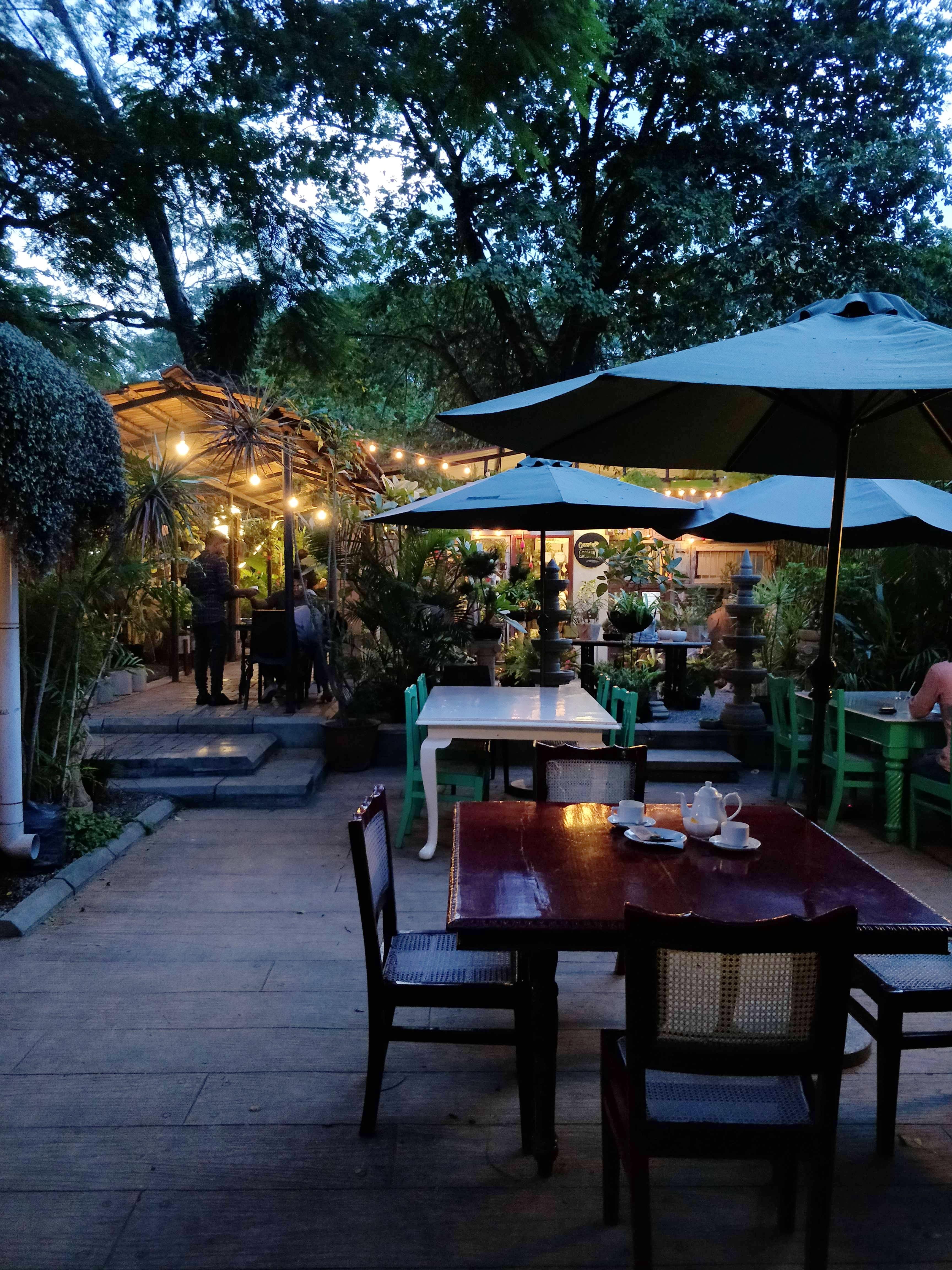 Restaurant,Sky,Lighting,Night,Tree,Evening,Table,Atmosphere,Patio,Building