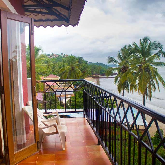 Property,Building,Balcony,House,Real estate,Room,Home,Resort,Tree,Porch