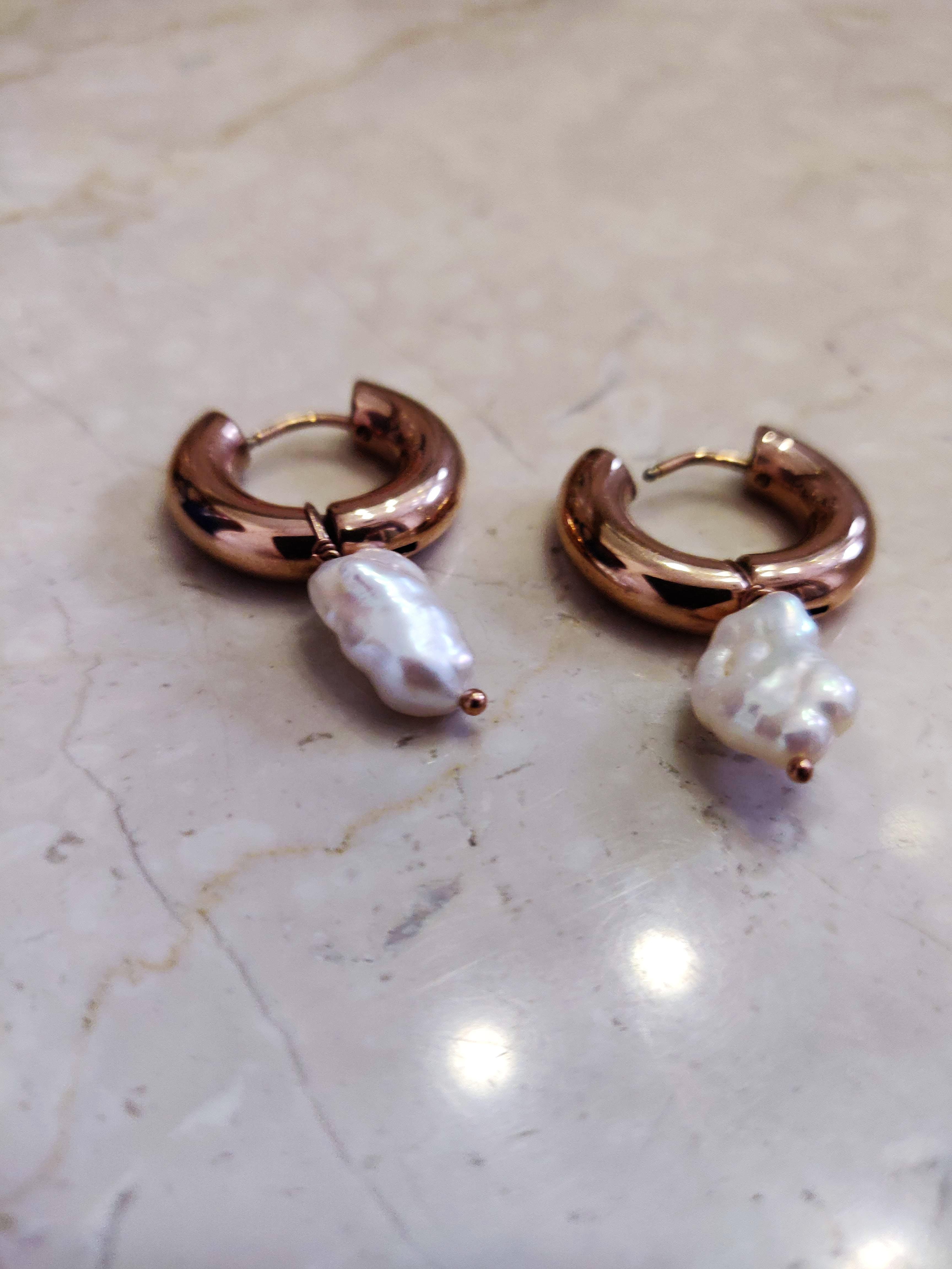 Body jewelry,Jewellery,Fashion accessory,Earrings,Metal,Silver,Ring,Ear,Silver,Gemstone