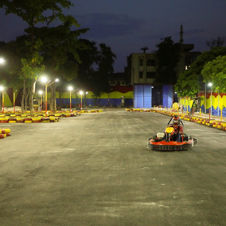 Kart racing,Go-kart,Asphalt,Vehicle,Road surface,Road,Car,Racing,Street,Night