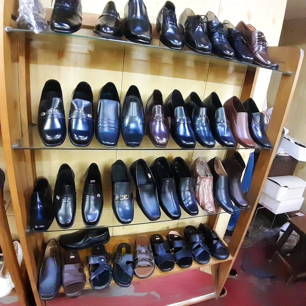 Footwear,Shoe store,Shoe,Collection,Shoe organizer,Shelf,Athletic shoe