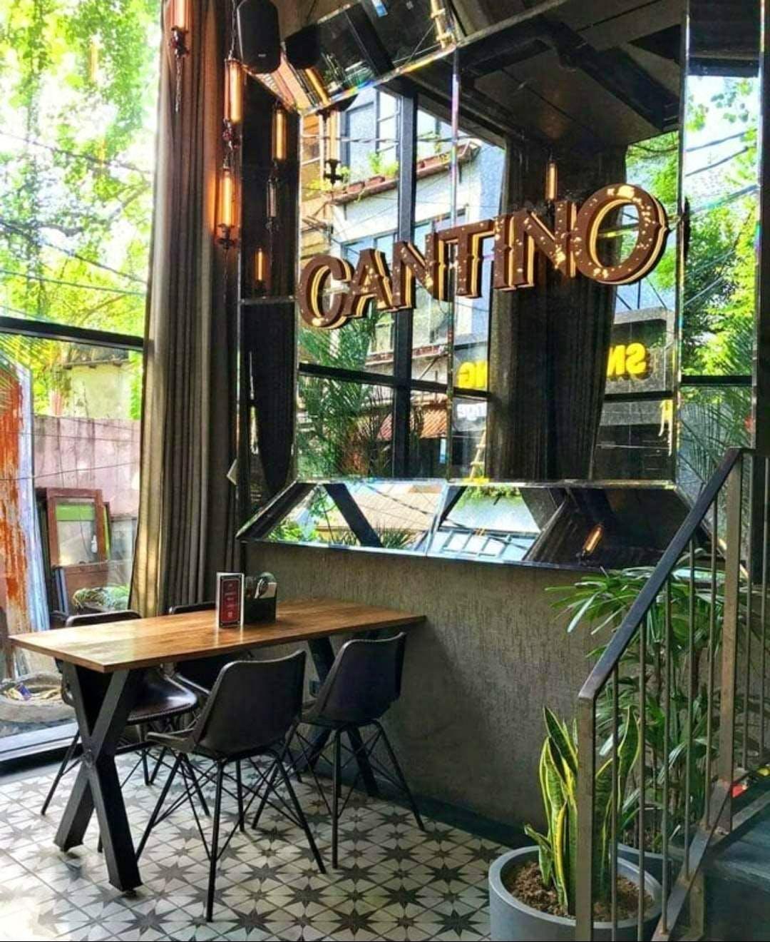 Building,Room,Restaurant,Coffeehouse,Table,Interior design,Café,Furniture,Plant,Porch