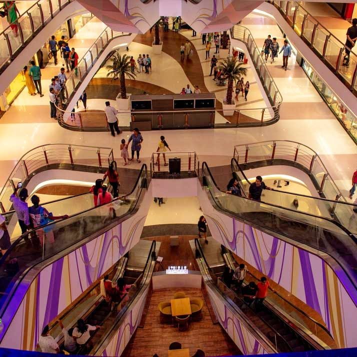Escalator,Shopping mall,Building,Architecture,Retail,Stairs