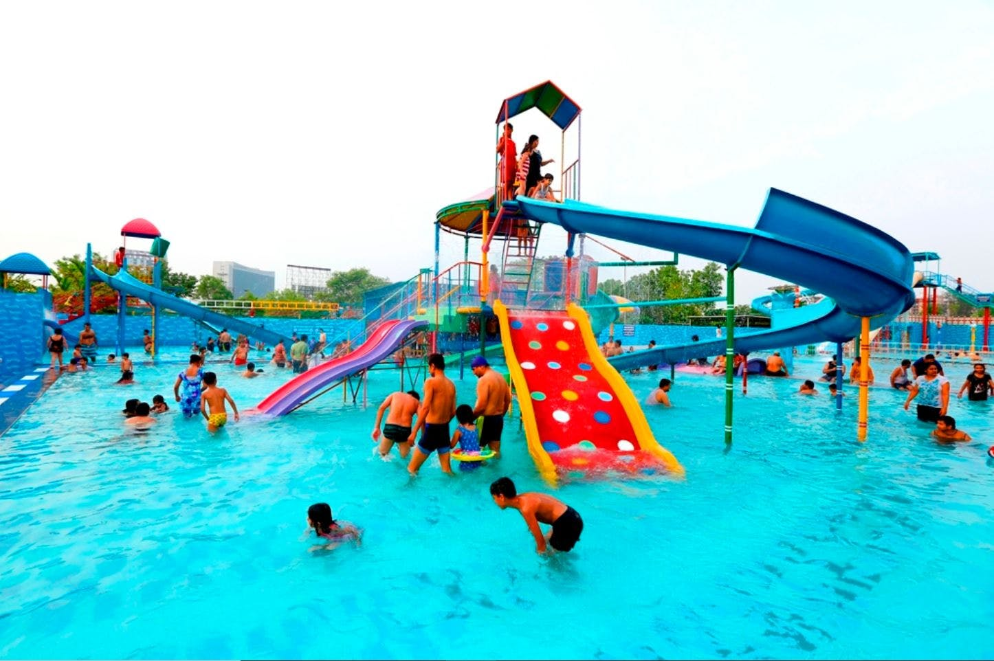 Water park,Swimming pool,Amusement park,Leisure,Recreation,Fun,Leisure centre,Park,Nonbuilding structure,Outdoor play equipment