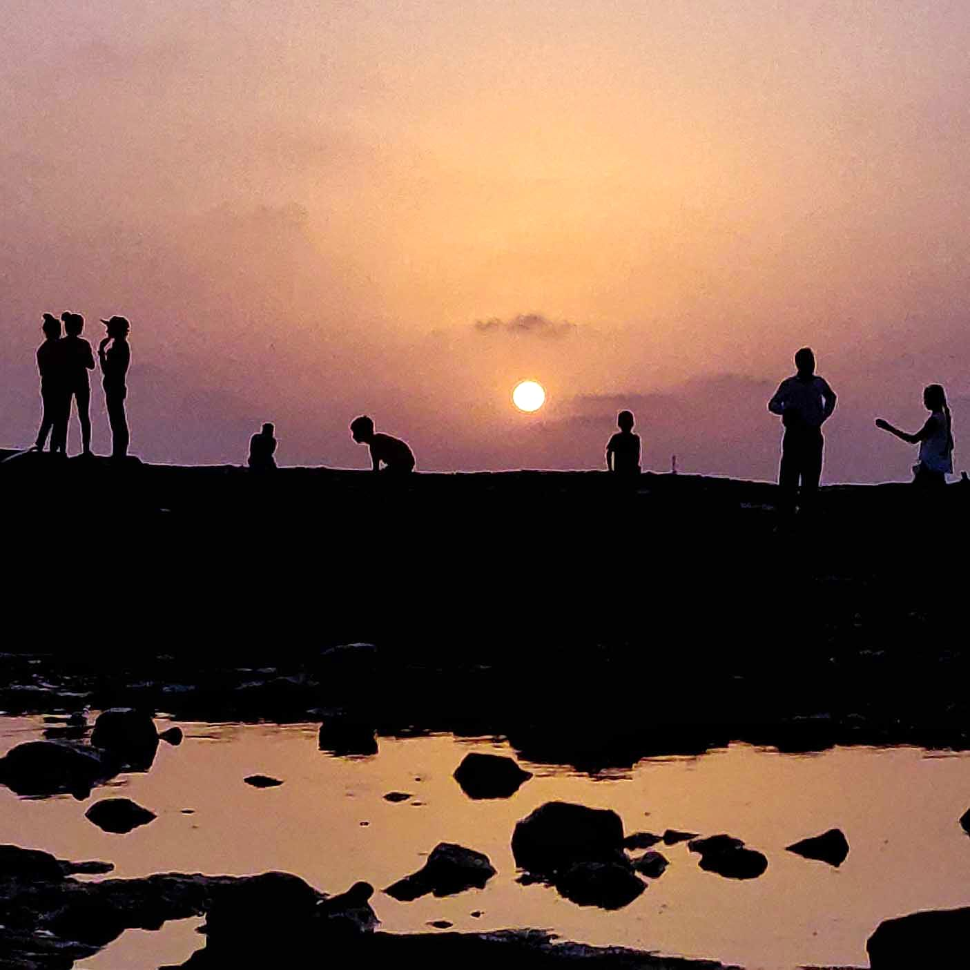 People in nature,Sky,Water,Silhouette,Sunset,Reflection,Horizon,Sea,Cloud,Evening