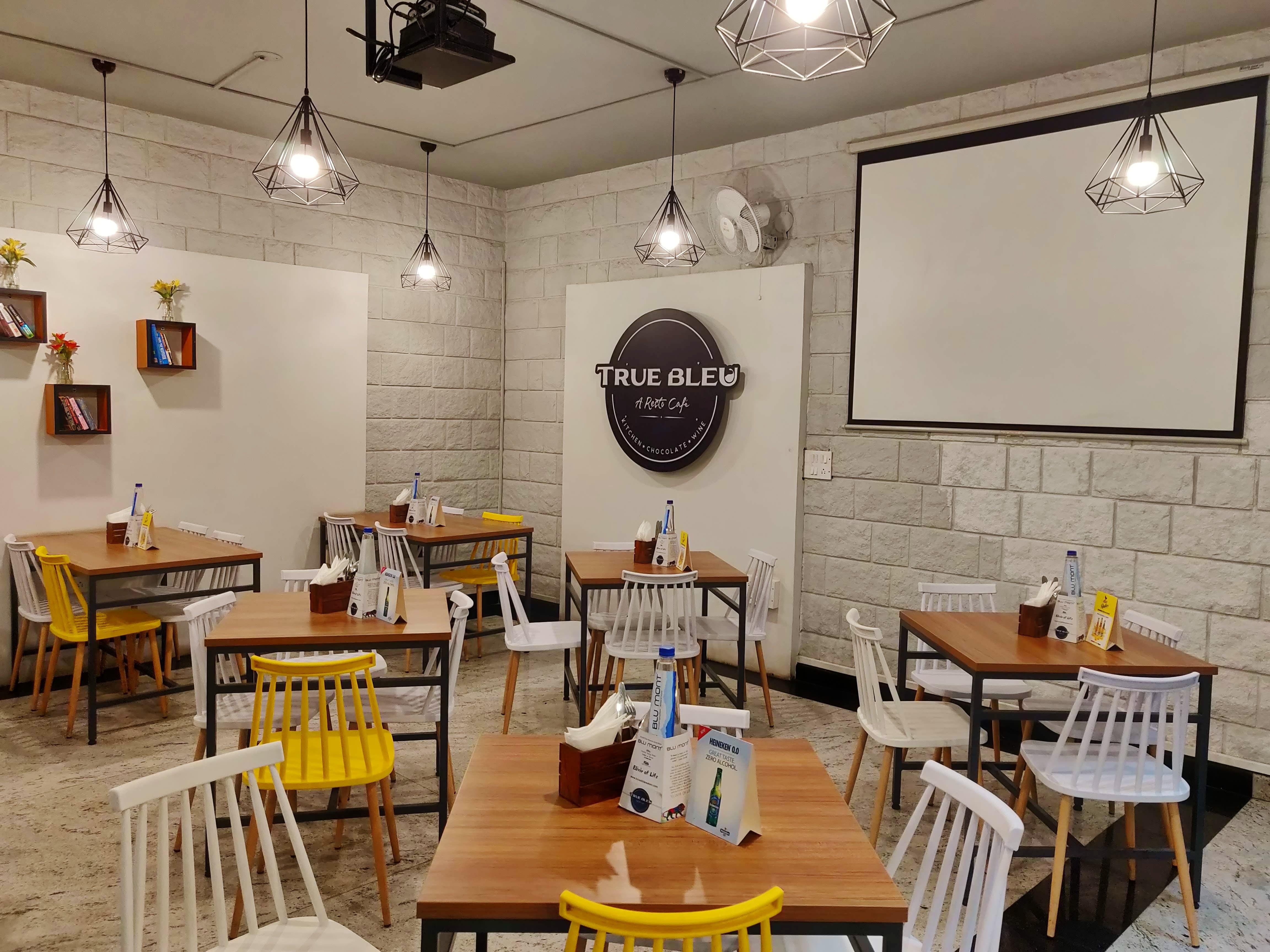 Room,Restaurant,Yellow,Building,Interior design,Table,Furniture,Dining room,Café,Cafeteria
