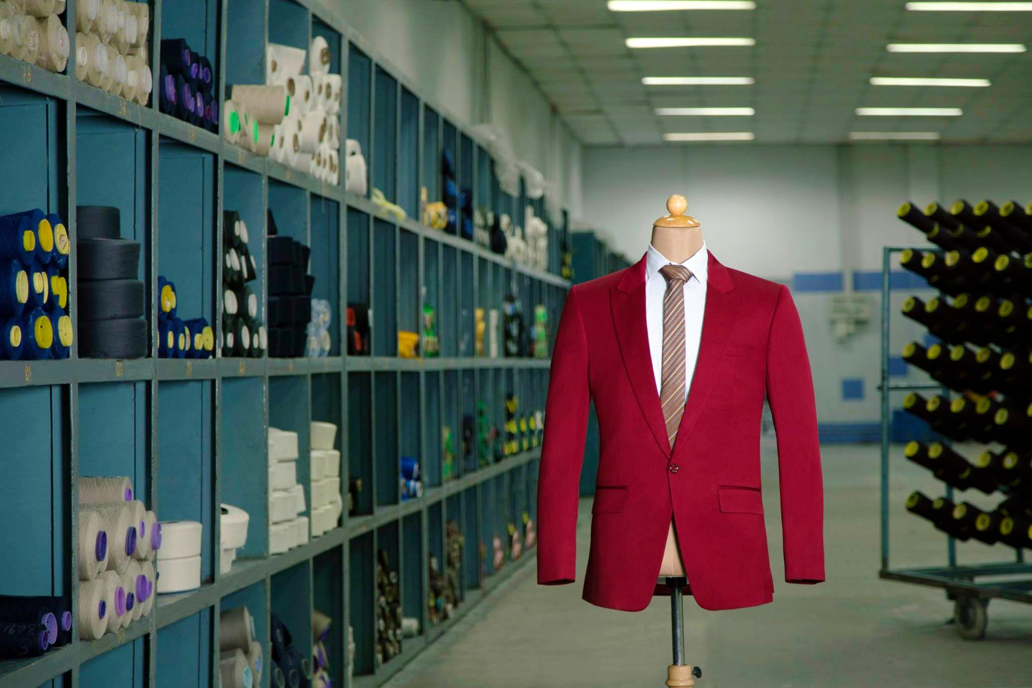 Suit,Outerwear,Room,Blazer,Formal wear,Building,Outlet store